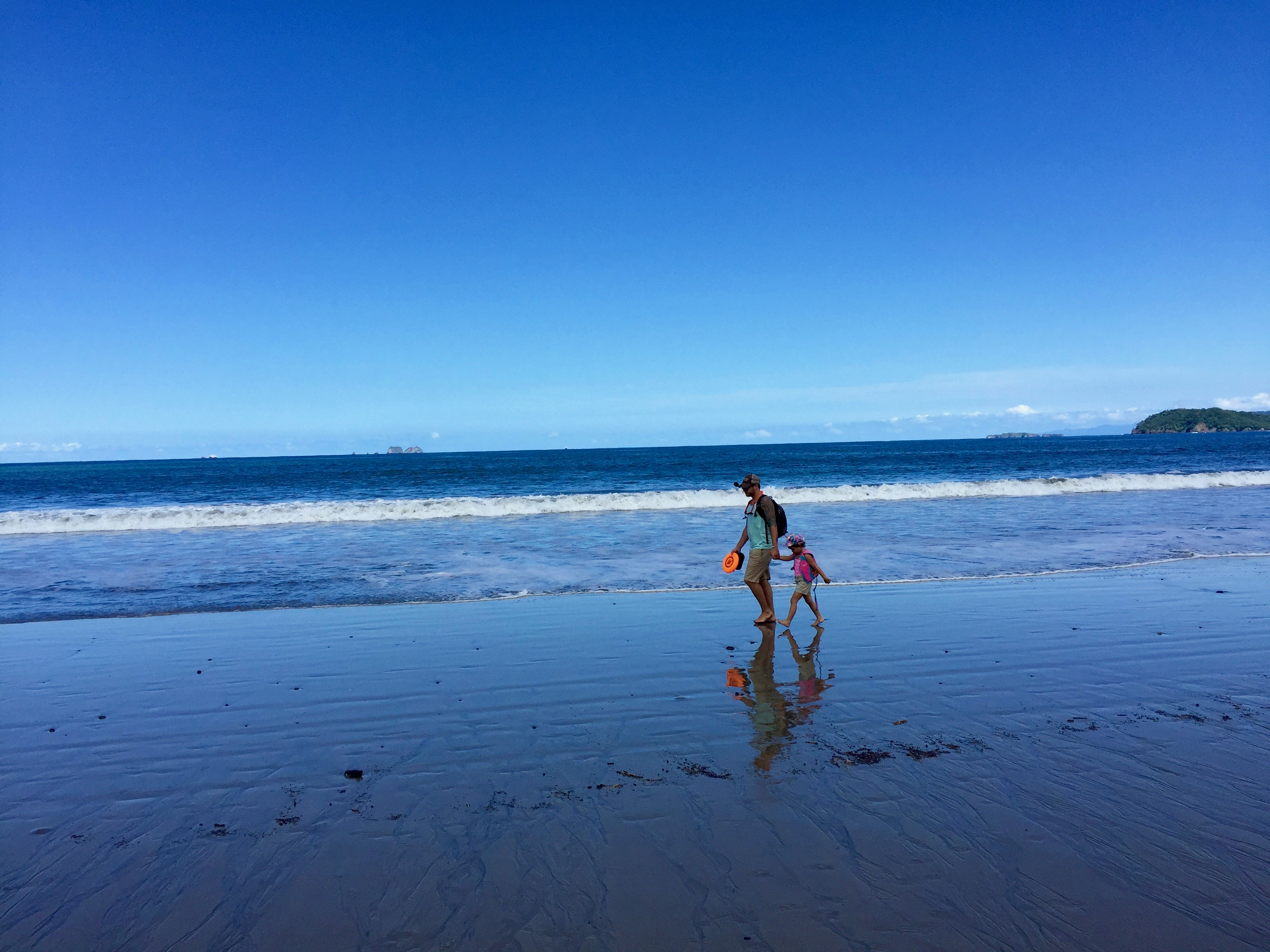 Josh Bolinger and his daughter Suria ont he beach in Costa Rica